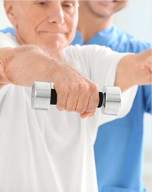 elderly man lifting small weights outfront of chest
