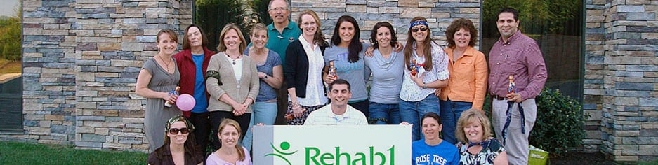 Rehab1 team standing infront of building